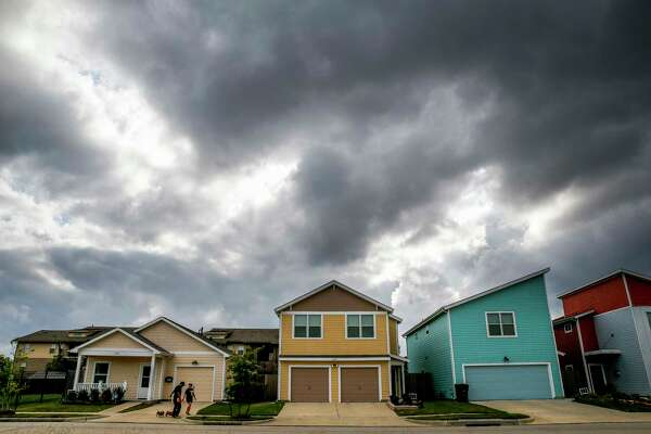 Michael and Diana Castillo walk their dogs around the Avenue Place affordable housing neighborhood Tuesday, April 25, 2017 in Houston. The city of Houston has wasted, misspent or lost track of tens of millions of affordable housing dollars over the last decade.