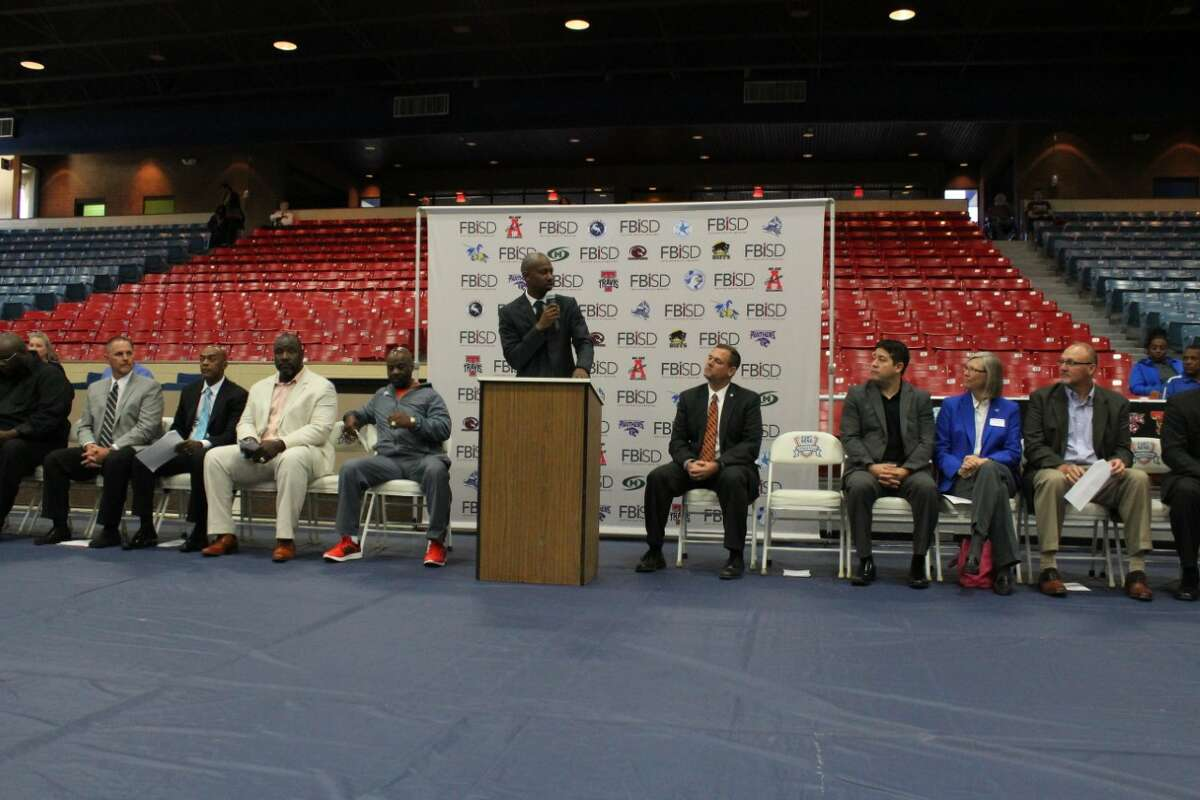 Willowridge graduate and NBA veteran T.J. Ford speaks during Fort Bend ISD's spring National Signing Day, May 5 at Wheeler Field House. FBISD honored 130 student-athletes who signed with college programs.