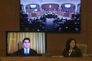 Council member Rey Saldaña attends the Thursday morning meeting via video conference so he can participate in council discussion about approval of the proposed Alamo master plan. Saldaña was in Los Angeles attending a conference.
