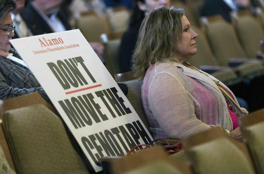 Lee Spencer White, Alamo Defenders Descendants Association president, sits Thursday with a sign showing her opposition to moving the Alamo Plaza cenotaph during council discussion about the proposed Alamo Plaza master plan. Photo: William Luther /San Antonio Express-News / © 2017 San Antonio Express-News