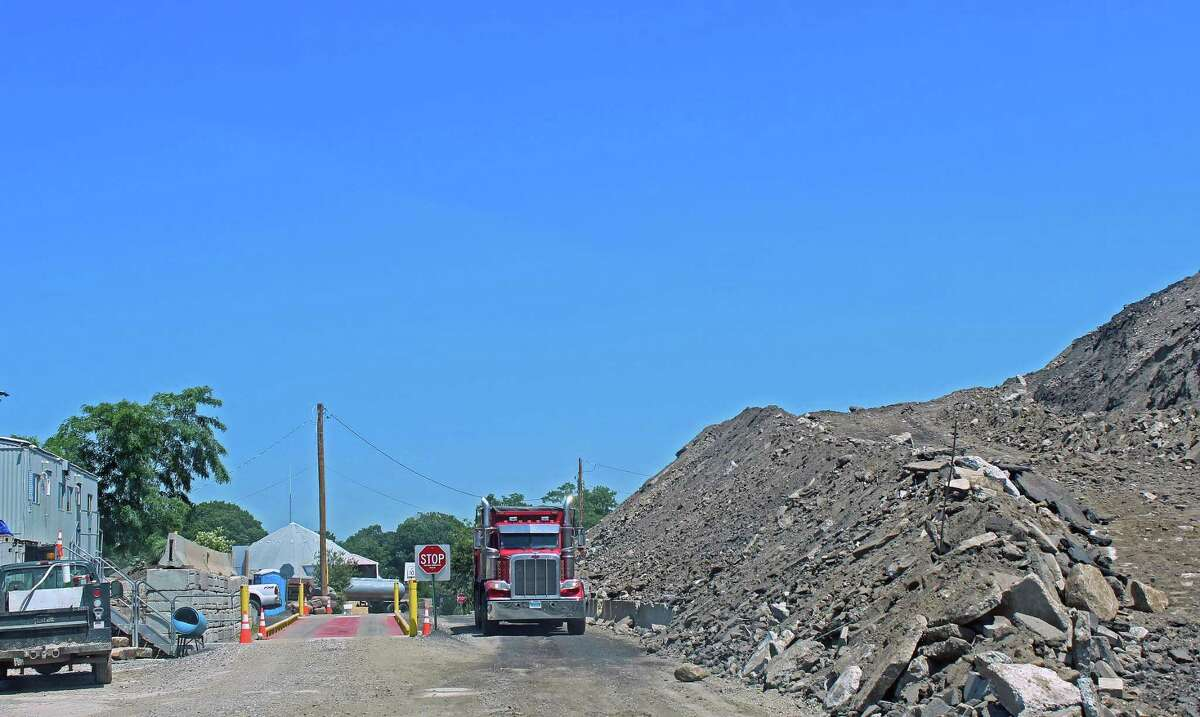 The town has filed suit against Julian Development for its failure to reduce the fill pile at One Rod Highway.