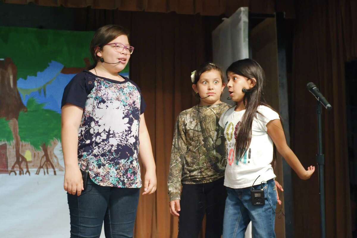 Jami Torres as Fiona, Natalia Nava as Donkey and Emily Olivo as Shrek rehearse their parts for the Mae Smythe Elementary school production of Shrek the Musical Jr.