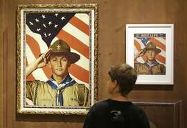 FILE - In this July 22, 2013, file photo, an 11-year-old boy looks over a Boy Scout-themed Norman Rockwell exhibition at the Church History Museum in Salt Lake City, Utah. The Mormon church, the largest sponsor of Boy Scouts troops in the United States, announced Thursday, May 11, 2017, it is pulling older teenagers from the organization as the religion takes a step toward developing its own global scouting-like program. (AP Photo/Rick Bowmer, File)