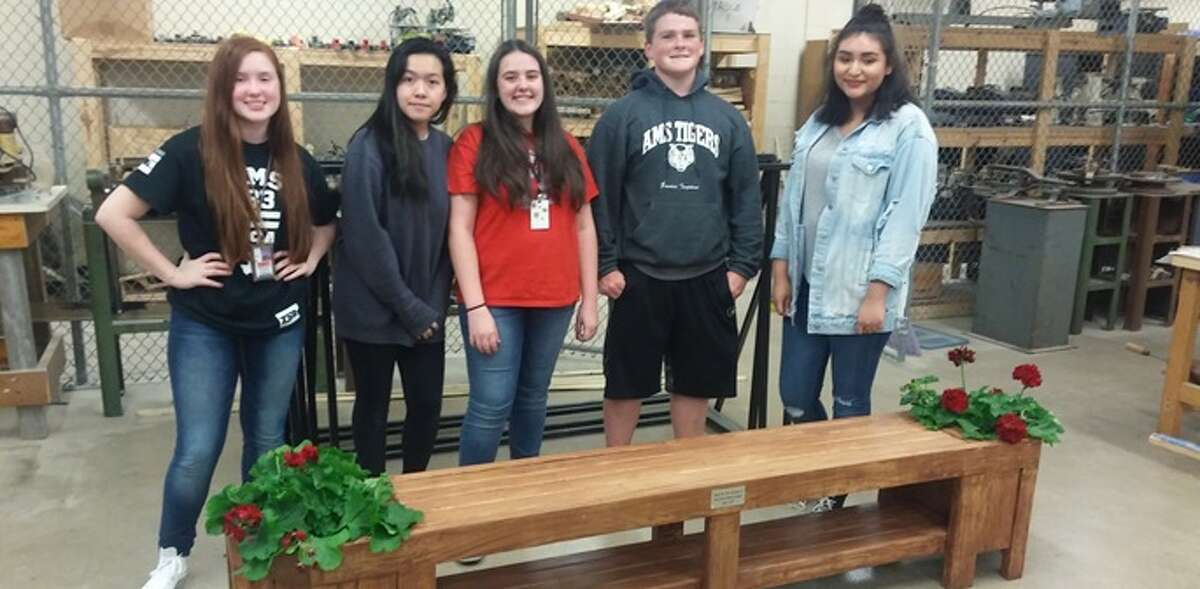 Atascocita Middle School Technology Student Associate donated custom built bench to The Door women's shelter.