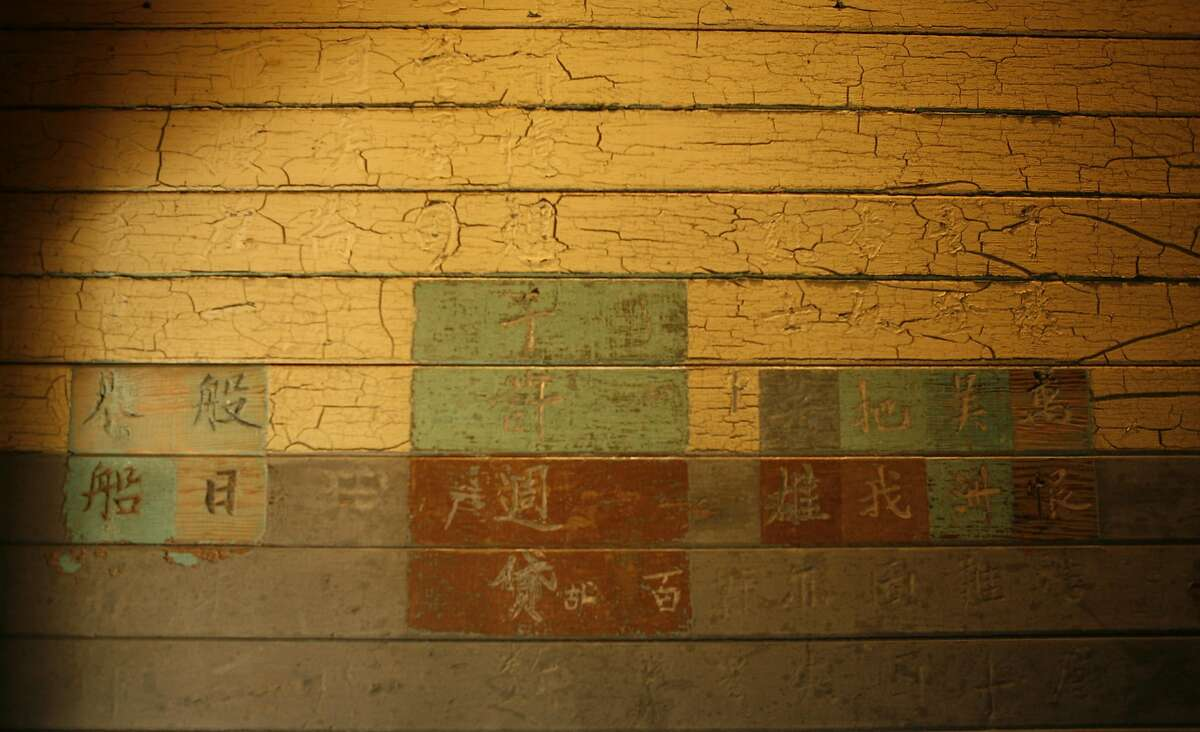 Inscribed Chinese poetry, written by former Chinese immigrants who were detained at the Angel Island Immigration Station, is seen along the walls of the detention barracks of on Angel Island State Park.