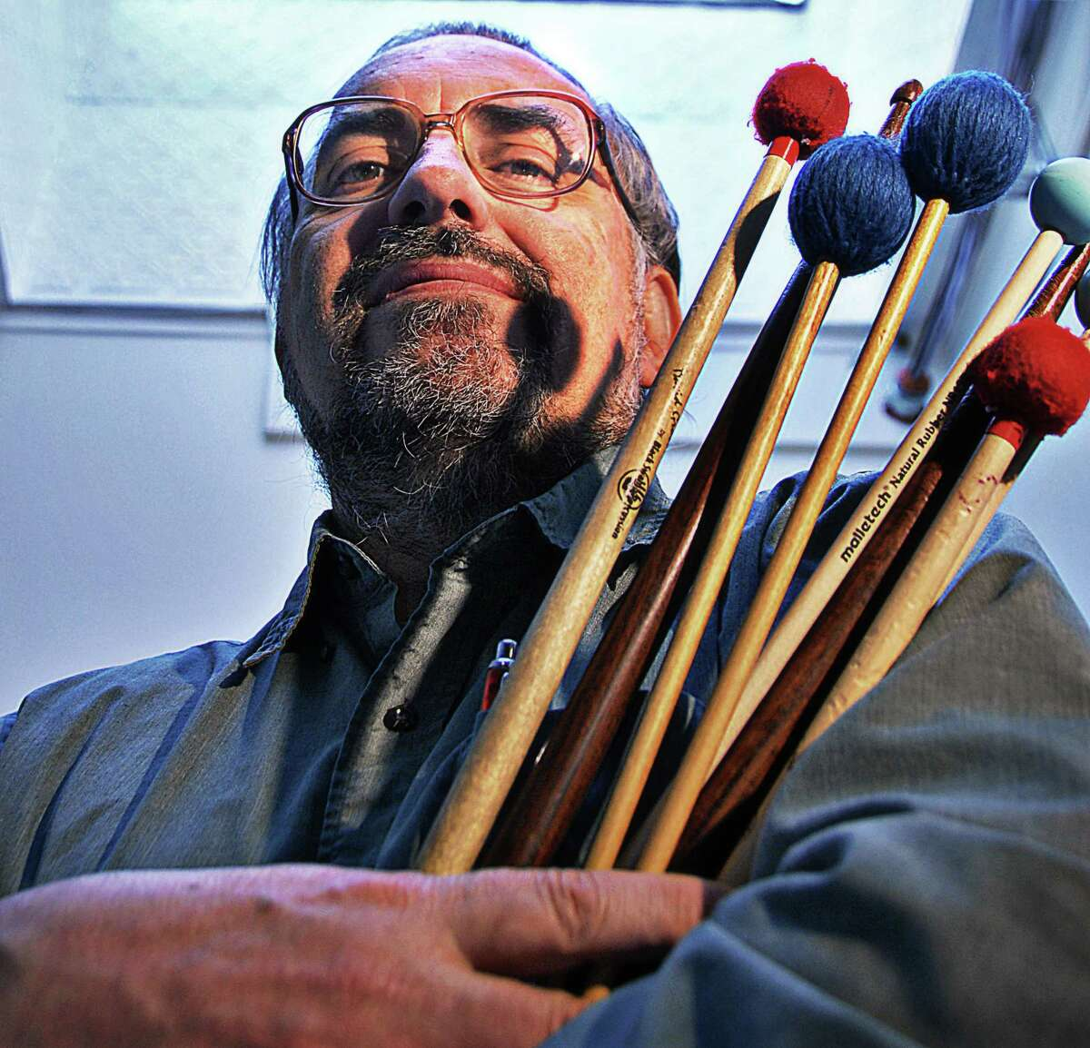 Times Union staff photo by John Carl D'Annibale: Professor of percussion at both UAlbany and RPI Richard Albagli poses with sticks and mallets at a rehearsal room in RPI's West Hall Wednesday afternoon November 21, 2007. FOR FURFARO STORY