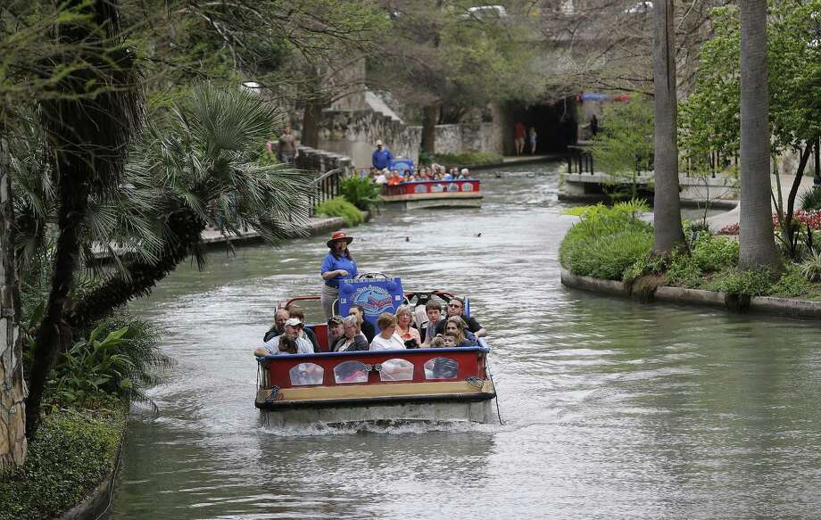 FILE PHOTO — River barges take people on a  guided tour along with River Walk on Mar. 16, 2017. The body of a 61-year-old man was found floating face down in the water on the River Walk on Sunday, May 21, 2017, according to police. He was transported to a downtown hospital and later pronounced dead. Photo: Kin Man Hui, Staff / San Antonio Express-News / ©2017 San Antonio Express-News