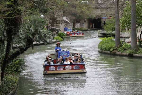 River barges take people on a  guided tour along with River Walk on Thursday, Mar. 16, 2017. (Kin Man Hui/San Antonio Express-News)