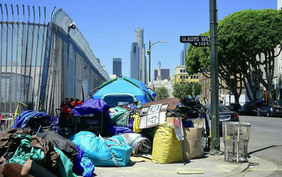 Tents housing the homeless and their belongings crowd a street corner in Los Angeles. The state's housing crisis has been years in the making. Photo: FREDERIC J. BROWN, AFP/Getty Images
