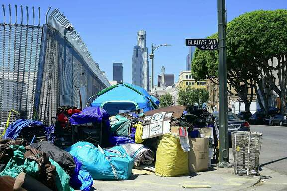 Tents housing the homeless and their belongings crowd a streetcorner  in downtown Los Angeles, California on April 20, 2017, where the city's mayor, Eric Garcetti, is proposing $176 million to help combat the city's growing homeless crisis. Los Angeles is home to one of the nation's largest homeless populations. / AFP PHOTO / Frederic J. BrownFREDERIC J. BROWN/AFP/Getty Images