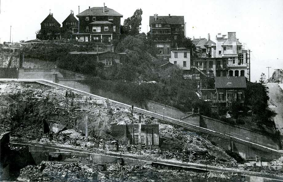 This photo courtesy of the California Historical Society depicts some of the 1906 earthquake and fire destruction, but also shows several houses that survived on Broadway and Vallejo Streets between Jones and Taylor. Among the survivors is the Atkinson-Escher House (at center left).