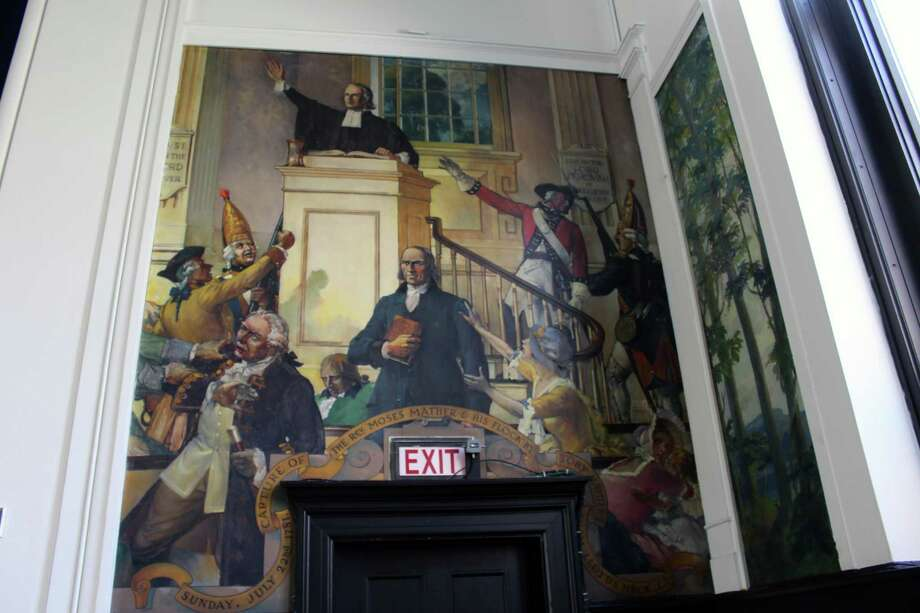 A mural in the Darien Town Hall Auditorium depicts the Tory raid of Middlesex Meeting House in 1781. Photo: Justin Papp / Hearst Connecticut Media / Darien News
