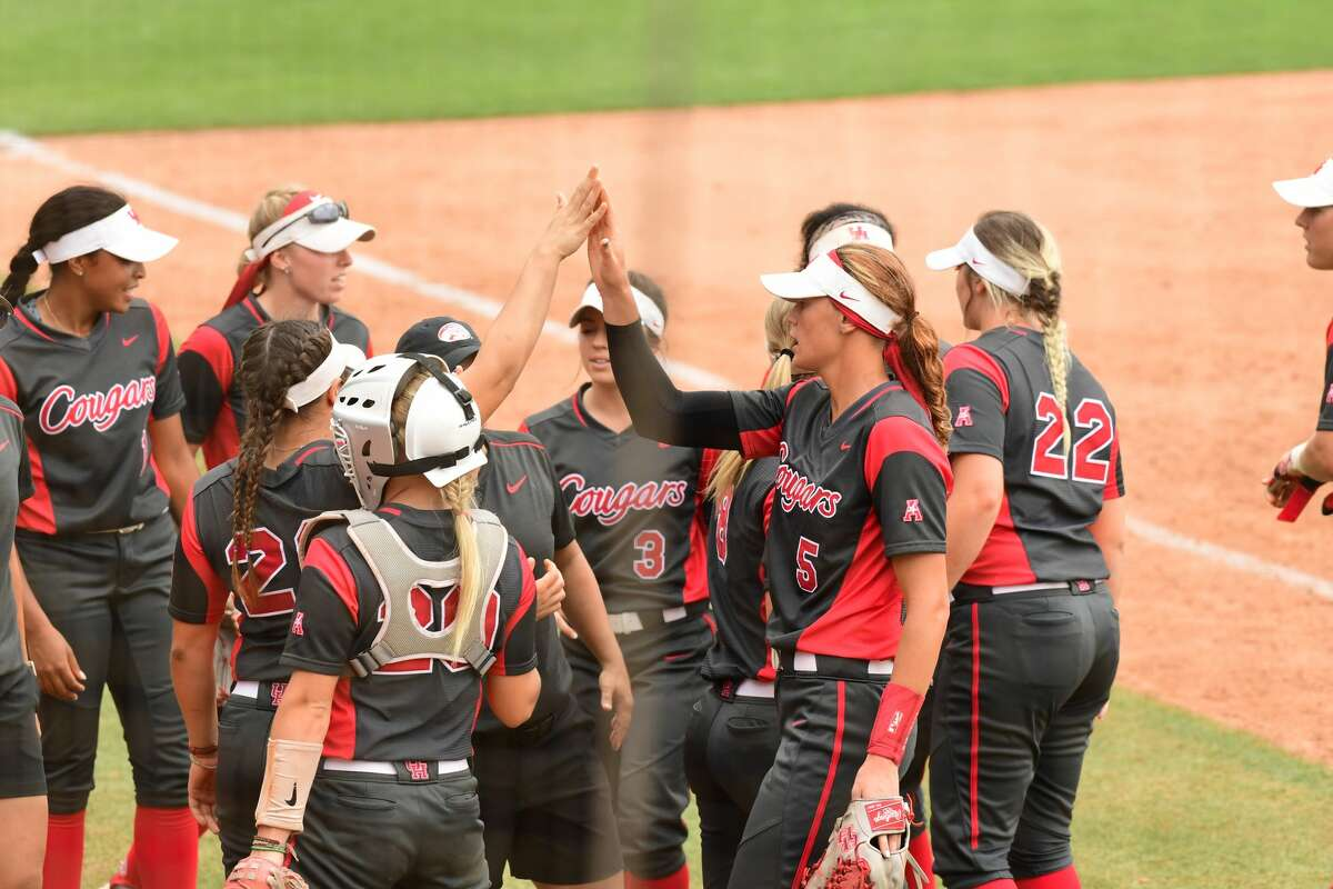 Houston pitcher Savannah Heebner is greeted by her teammates in the AAC semifinal Thursday.