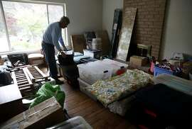 Chris Leister packs moving boxes at his home in Castro Valley, Calif. on Thursday, May 11, 2017 before he and his wife Carol relocate to El Dorado County. The Leisters are taking advantage of Prop. 60, which lets people 55 and older transfer their property tax base from their current home to a replacement home, thus avoiding a potentially steep increase in property taxes.