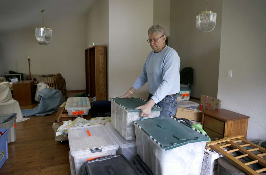 Chris Leister packs moving boxes at his home in Castro Valley, Calif. on Thursday, May 11, 2017 before he and his wife Carol relocate to El Dorado County. The Leisters are taking advantage of Prop. 60, which lets people 55 and older transfer their property tax base from their current home to a replacement home, thus avoiding a potentially steep increase in property taxes. Photo: Paul Chinn, The Chronicle