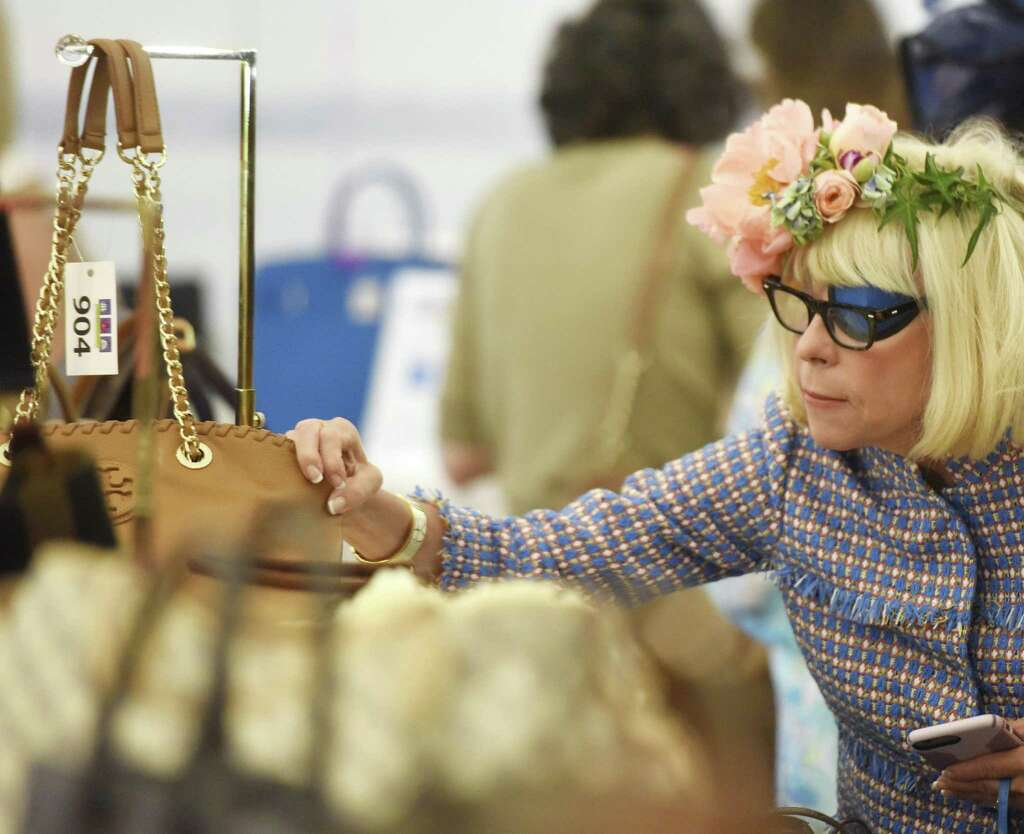 Mary Ann Henry Of Pund Ridge N Y Looks At A Handbag Up For
