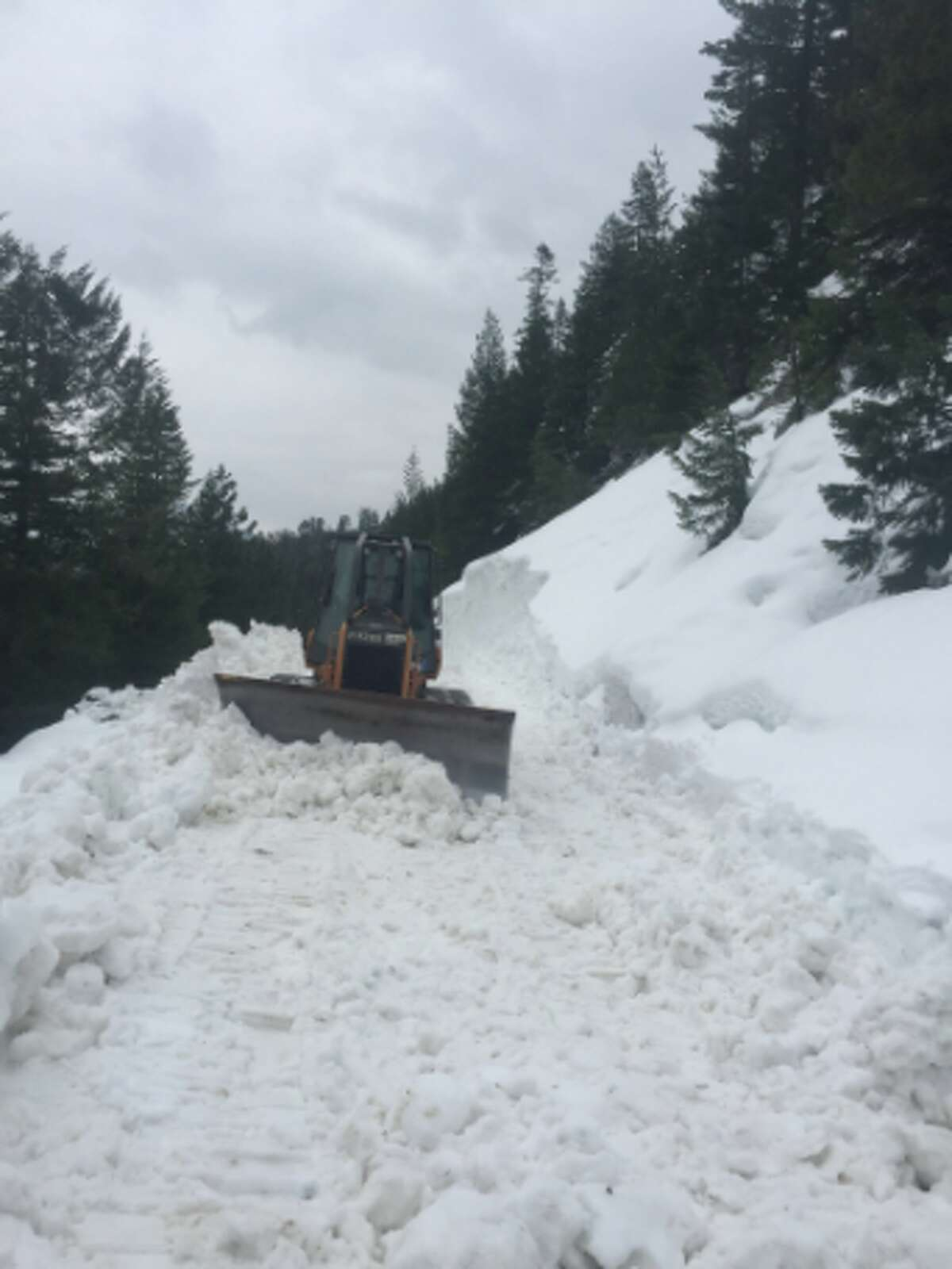 A Caltrans grader clears snow off Highway 108 over Sonora Pass in Tuolumne County in April 2017.