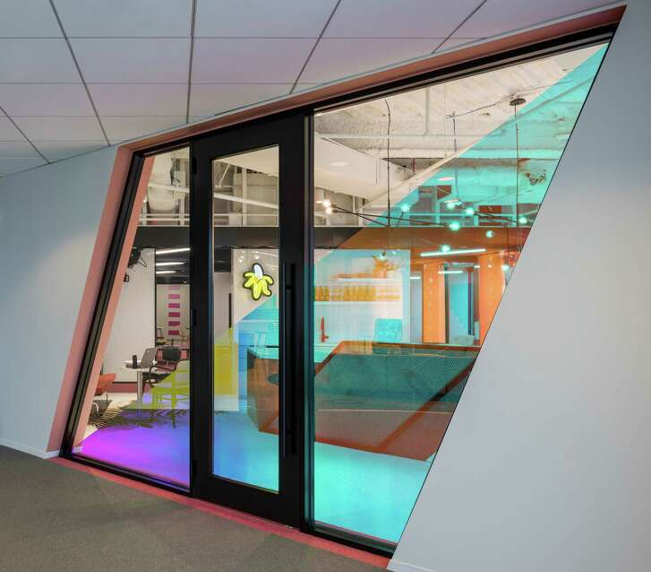 "From Ziegler Cooper's ""DesignHive"" project: An angular front door of dichroaic glass."