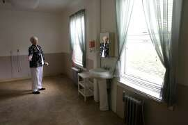 Sister Patricia, director shows what would become the kitchen and dining room area of the proposed project at the Lady of Lourdes Convent on Thursday May 11, 2017, San Rafael, Ca. The Lady of Lourdes convent is seeking permission from city of San Rafael to house two single mothers and their young kids in a vacant wing of their assisted living center where about 16 elderly nuns live.