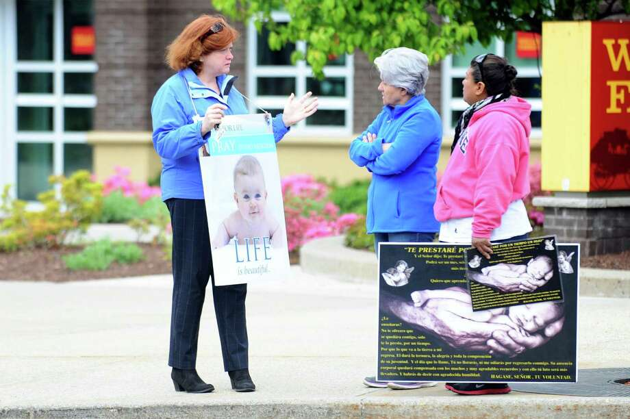 A group of pro-life advocates in front of Planned Parenthood on 6th Street in Stamford on Wednesday. Photo: Michael Cummo / Hearst Connecticut Media / Stamford Advocate