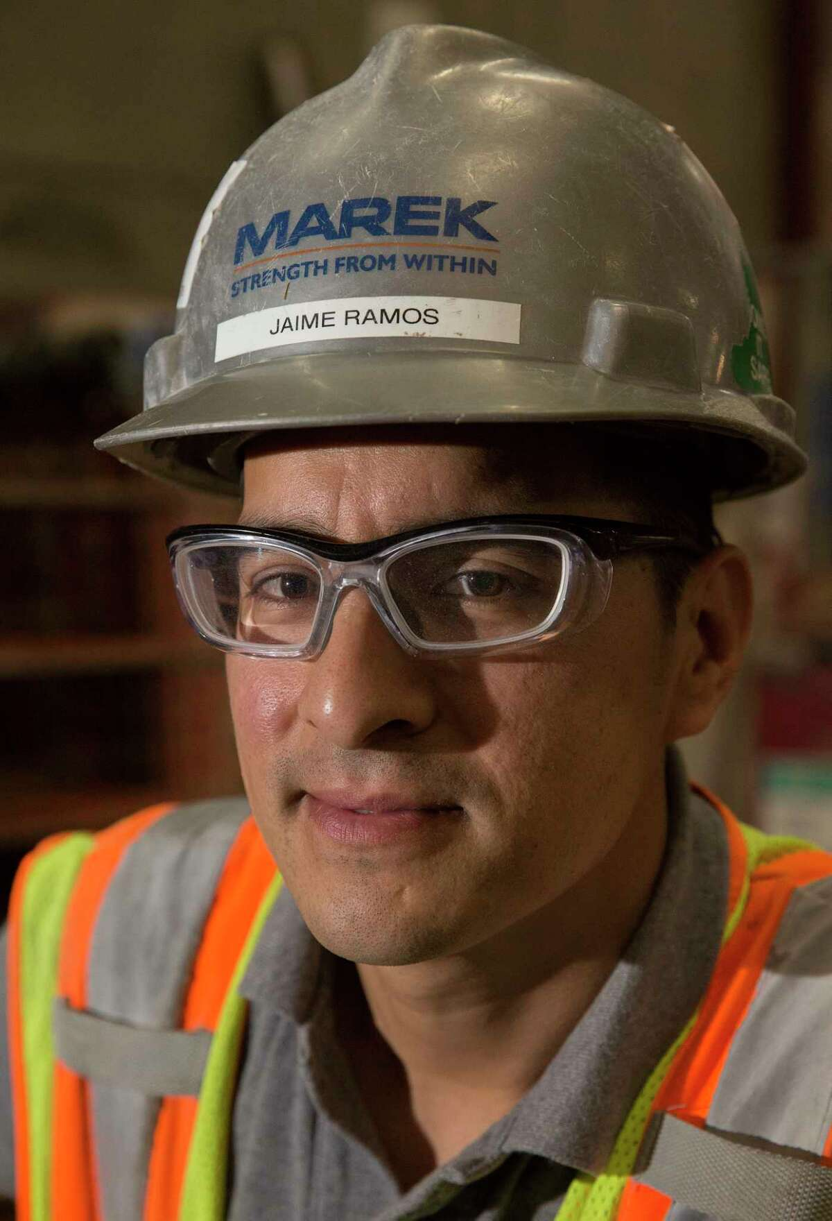 Jaime Ramos, a 30-year-old construction foreman, poses for a portrait at the Marek Brothers Systems Inc. warehouse Friday, May 5, 2017, in Houston. Marek has established it's own training programs for craft workers, and Ramos has completed the program. ( Yi-Chin Lee / Houston Chronicle )