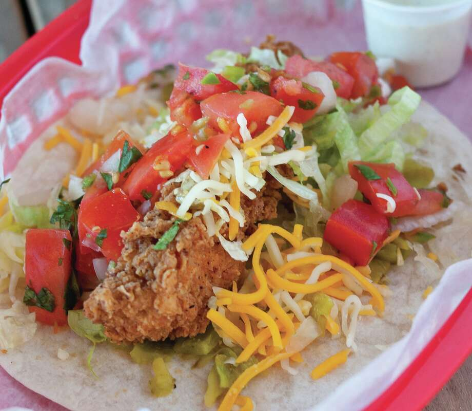 Torchy's Tacos opens in Cypress on April 3. Featured here is the Trailer Park taco. Photo: Courtesy Of Torchy's Tacos