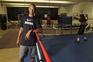 Eastside Boys & Girls Club head boxing coach Jeff Mays poses in the gym on Feb. 13, 2014.