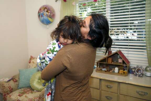 Natalie Ruiz awakens her 3-year-old daughter Clara Blanchard in their University Village apartment in Albany, Calif. on Thursday, May 11, 2017. Ruiz will be be giving a commencement speech to her graduating UC Berkeley sociology department class on Sunday.