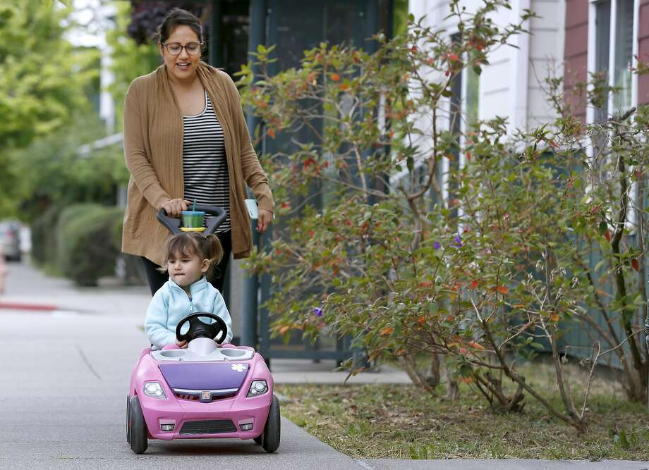 Natalie Ruiz escorts her 3-year-old daughter Clara Blanchard to preschool at University Village in Albany, Calif. on Thursday, May 11, 2017. Ruiz will be be giving a commencement speech to her graduating UC Berkeley sociology department class on Sunday. Photo: Paul Chinn, The Chronicle