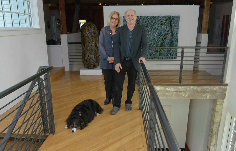 Tom Grotta and Rhonda Brown discuss the numerous sculptures, wall works and other fiber art they have adorning their 10,000-square-foot home Wednesday, May 10, 2017, which they open to the public for only a couple weeks each year as an art gallery in Wilton, Conn. Their home has seen thousands of visitors in the 30 years since they started the BrownGrotta Gallery, and now that this year's gallery has closed they've transformed it back into their personal home. Photo: Erik Trautmann / Hearst Connecticut Media / Norwalk Hour
