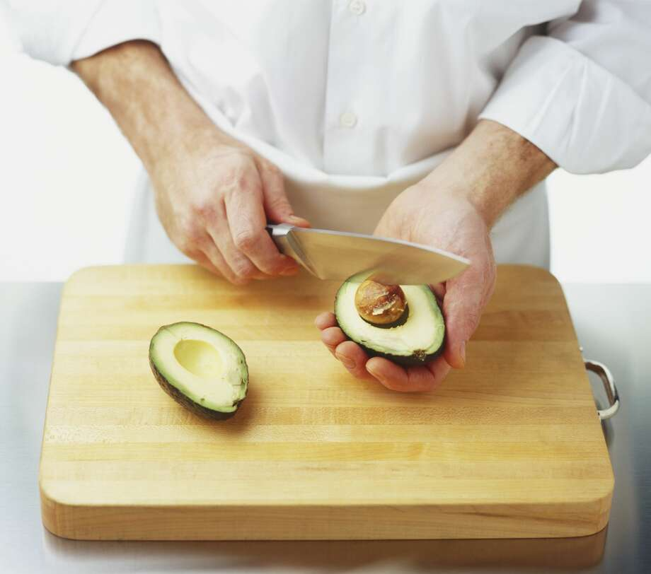 Cutting avocados is tricky business and leads to hand injuries each year. Photo: Dorling Kindersley/Getty Images/Dorling Kindersley
