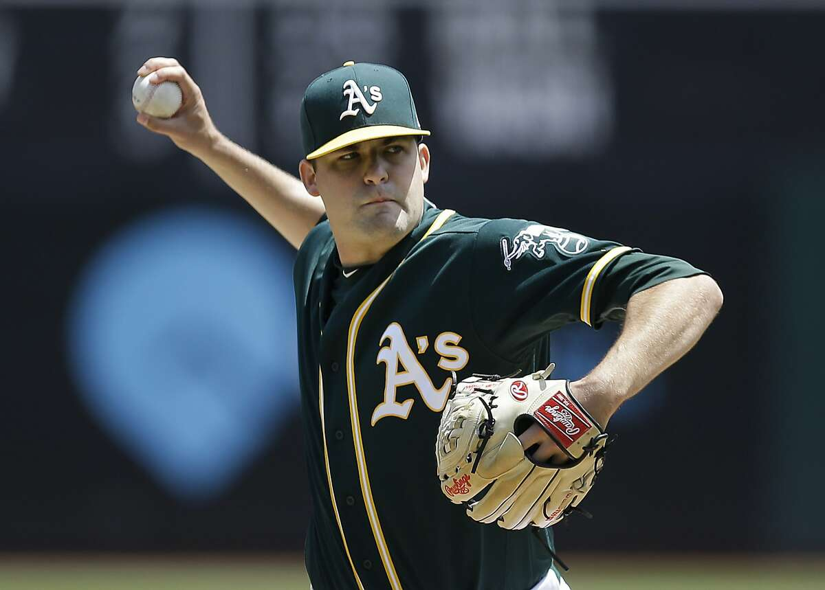 Oakland Athletics pitcher Andrew Triggs works against the Los Angeles Angels in the first inning of a baseball game Wednesday, May 10, 2017, in Oakland, Calif. (AP Photo/Ben Margot)