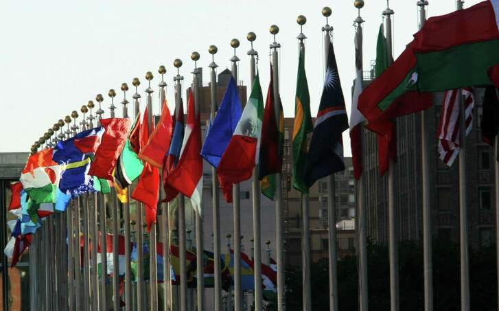 Flags are shown fluttering in the wind outside United Nations headquarters in New York. (AFP/Getty Images)