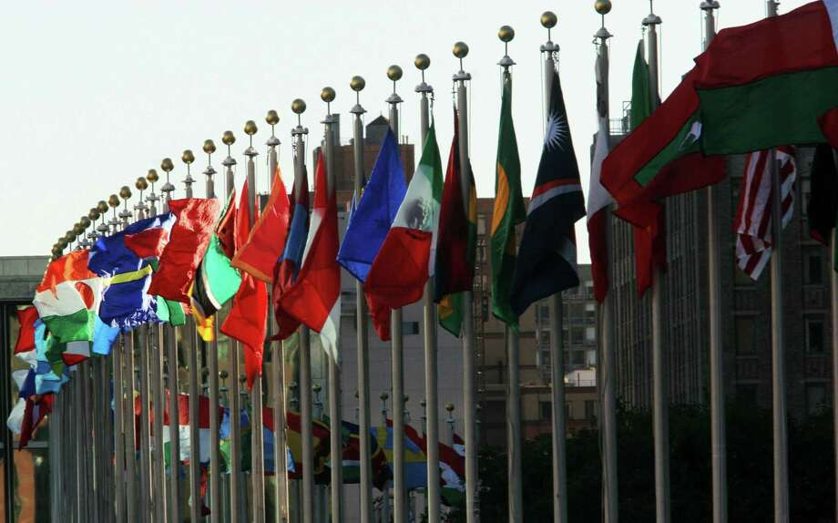Flags are shown fluttering in the wind outside United Nations headquarters in New York. (AFP/Getty Images) Photo: NICHOLAS KAMM, Staff / Getty Images