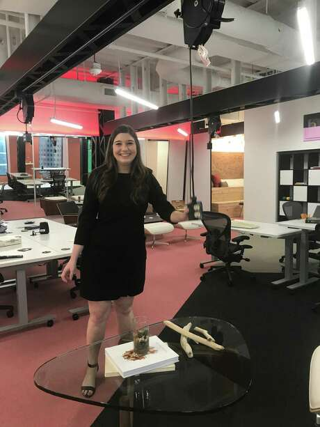 "Creative outlets: Project designer Laura Nagala shows the electrical outlets on pulleys that are part of Ziegler Cooper's ""DesignHive"" office suite. Photo: Molly Glentzer, Houston Chronicle"