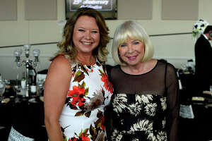 Kimberly Cochran and Cindy Lindsay at Beaumont Main Street's 25th anniversary celebration at the The Event Centre on Thursday.  Photo taken Thursday 5/11/17 Ryan Pelham/The Enterprise