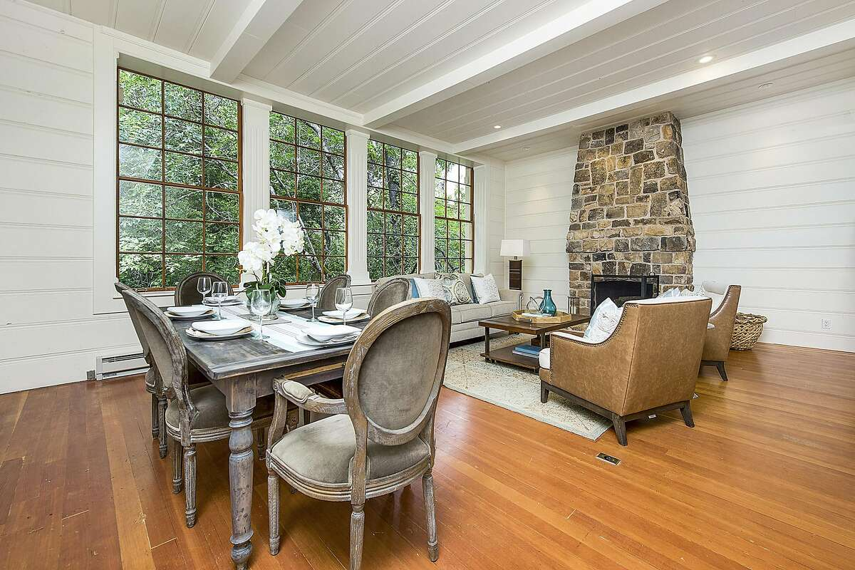 When the listing was a schoolhouse, the chalkboard stood where the fireplace now resides.