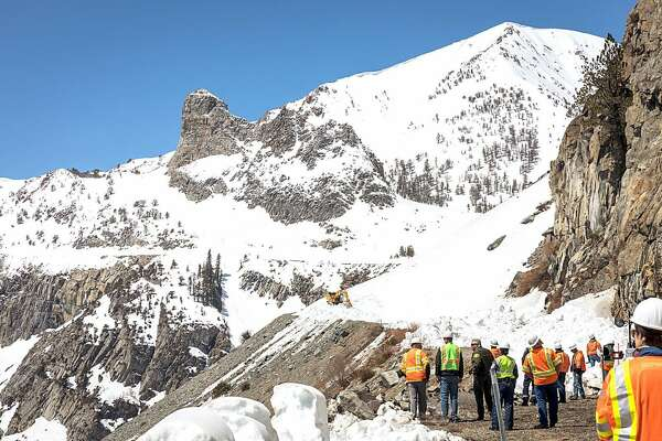 Caltrans employees work on clearing road over Tioga Pass, April 2017.