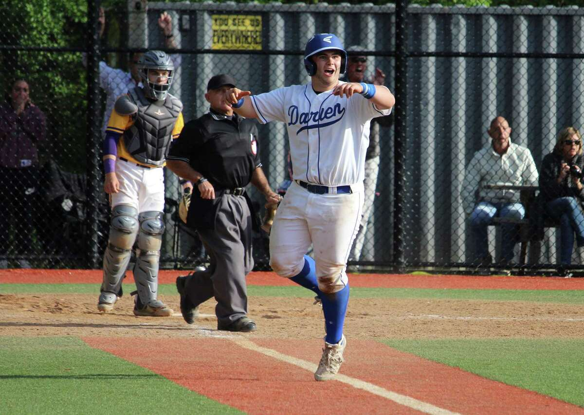 Darien's Sean O'Malley celebrates as his sixth-inning three-run homerun clears the fence during an FCIAC baseball game between Darien and Westhill on May 11, 2017 at Darien High School in Darien, Conn. Westhill defeated Darien 10-8.