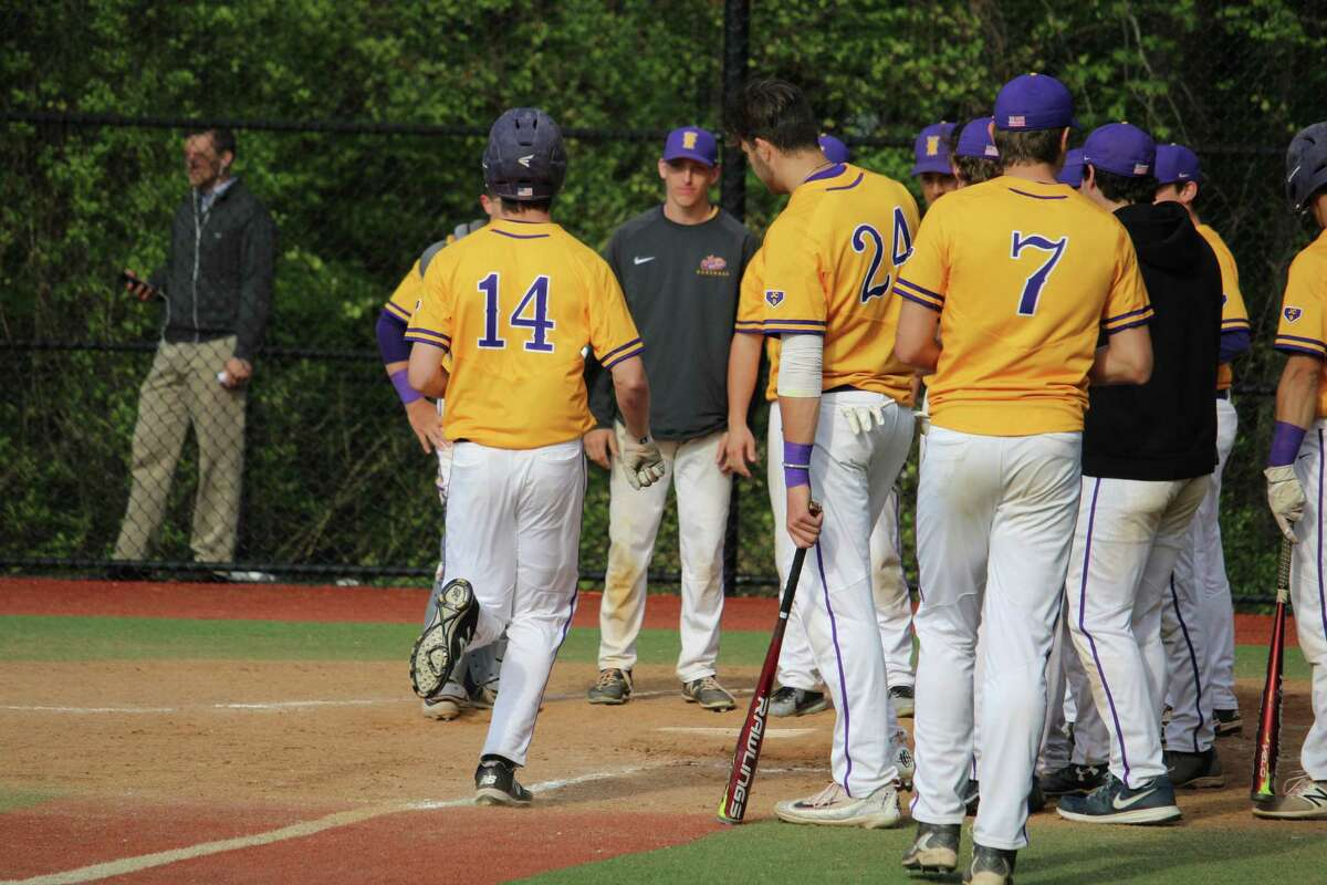 Westhill's Robert Zmarzlak crosses home plate after going back-to-back with Timothy Wainwright for his second homerun during an FCIAC baseball game between Darien and Westhill on May 11, 2017 at Darien High School in Darien, Conn. Westhill defeated Darien 10-8.