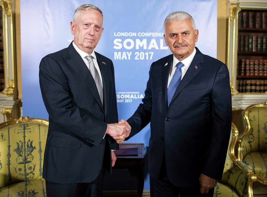 Turkey's Prime Minister Binali Yildirim, right, shakes hands with U.S. Secretary of Defense James Mattis, ahead of the Somalia Conference, in London, Thursday, May 11, 2017. (Prime Minister's Press Service, Pool Photo via AP) Photo: POOL / Prime Minister's Press Service