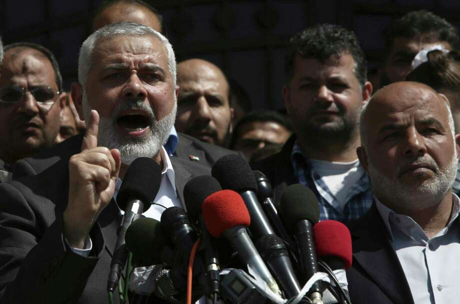 Hamas Supreme Leader Ismail Haniyeh announces the arrest of a suspect in the March shooting death of Mazen Faqha, a top Hamas militant commander, in a hastily arranged news conference in front of Fagha's home, in Gaza City, Thursday, May 11, 2017. Haniyeh refused to identify the suspect, but said that Hamas had determined the gunman, apparently a local Palestinian, had acted on the orders of Israel and he expected the suspect would face execution. (AP Photo/Adel Hana) Photo: Adel Hana, STF / Copyright 2017 The Associated Press. All rights reserved.
