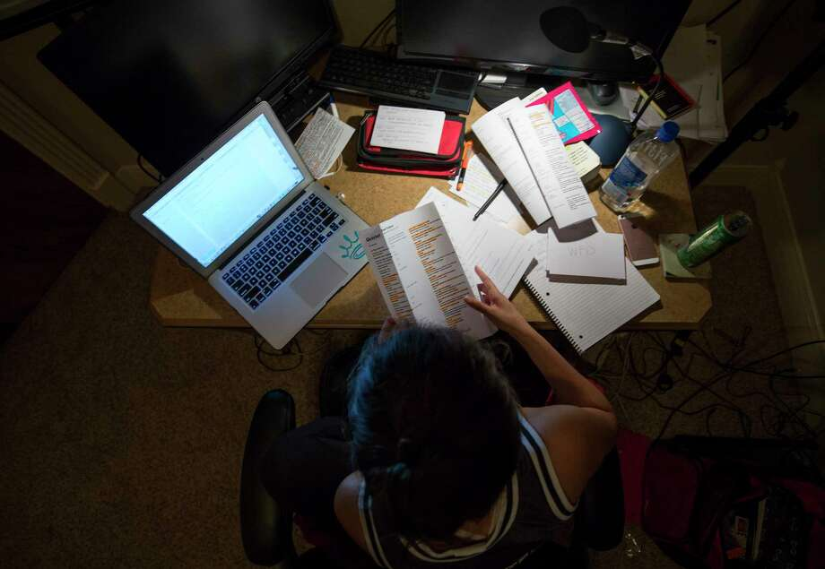 Amanda Chapa, a senior at the University of Houston, pulls her last all-nighter this week ahead of two final exams. The 22-year-old will receive her diploma on Sunday. Photo: Godofredo A. Vasquez, Staff / Godofredo A. Vasquez