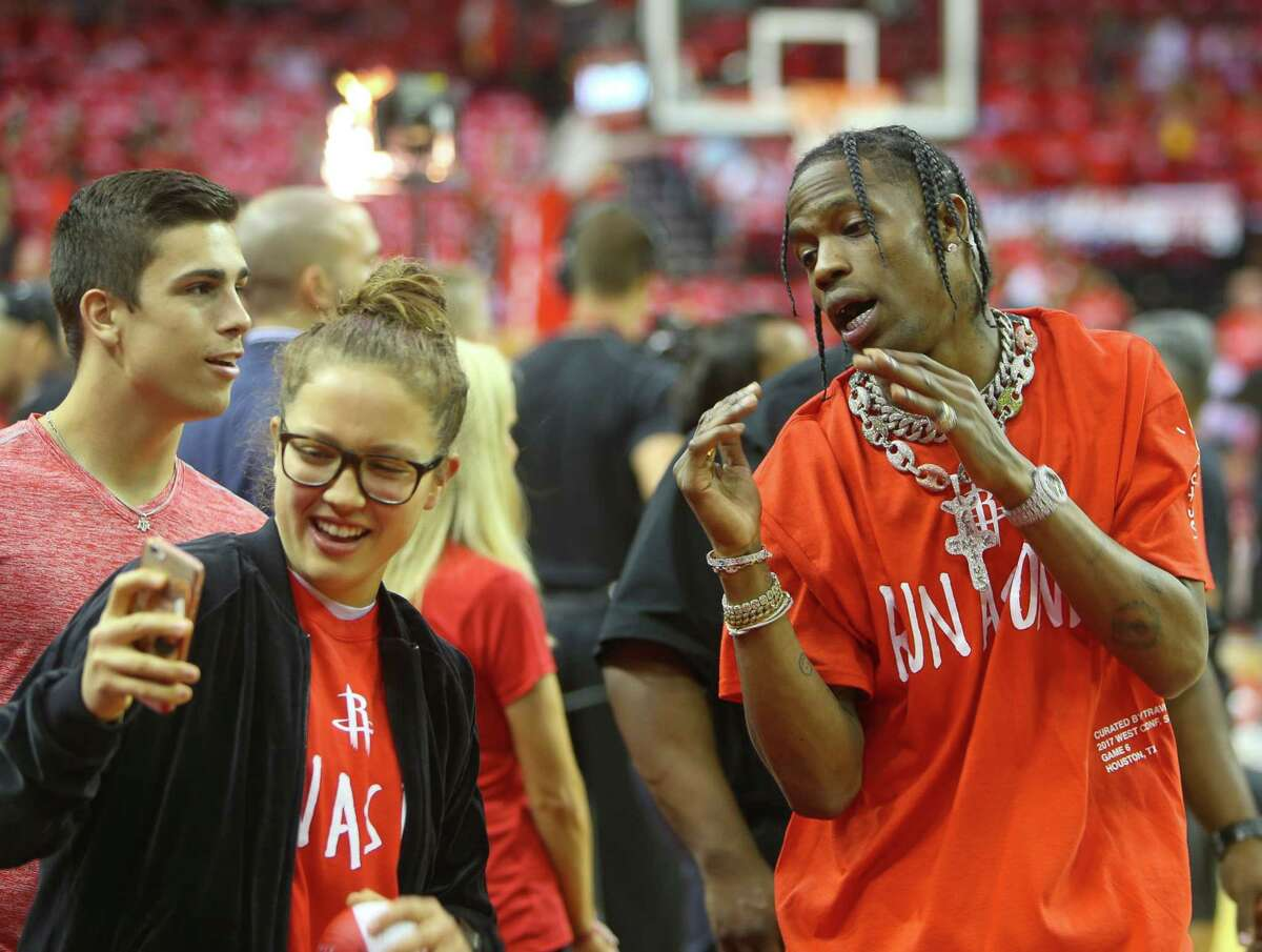 Travis Scott takes a picture with a fan before the first half of Game 6 of the Western Conference semi-final series between the Houston Rockets and San Antonio Spurs at Toyota Center, Thursday, May 11, 2017, in Houston.