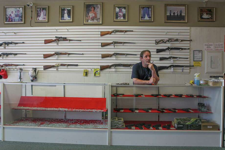 Greg Bell, owner of R&G Guns, said his store was robbed earlier this week but the support of his friends and customers has proven to him that his business is important to the community. Photo: Steve Gonzales, Staff / © 2017 Houston Chronicle