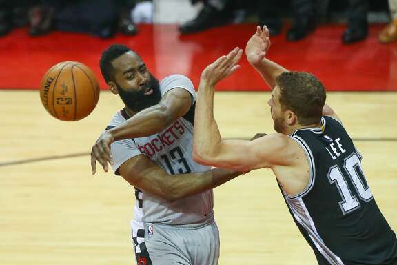 Houston Rockets guard James Harden (13) passes past San Antonio Spurs forward David Lee (10) during the first half of Game 6 of the Western Conference semi-final series between the Houston Rockets and San Antonio Spurs at Toyota Center, Thursday, May 11, 2017, in Houston. (Mark Mulligan / Houston Chronicle)