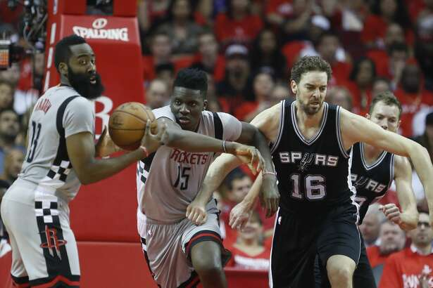 Houston Rockets guard James Harden (13) grabs a rebound as Clint Capela (15) and San Antonio Spurs center Pau Gasol (16) locked arms during the first half of Game 6 of the second round of the Western Conference NBA playoffs at the Toyota Center, Thursday, May 11, 2017, in Houston. ( Karen Warren / Houston Chronicle )