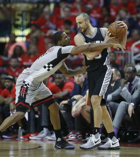 Houston Rockets forward Trevor Ariza (1) reaches for the ball held by San Antonio Spurs guard Manu Ginobili (20) during the first half of Game 6 of the second round of the Western Conference NBA playoffs at the Toyota Center, Thursday, May 11, 2017, in Houston. ( Karen Warren / Houston Chronicle ) Photo: Karen Warren/Houston Chronicle
