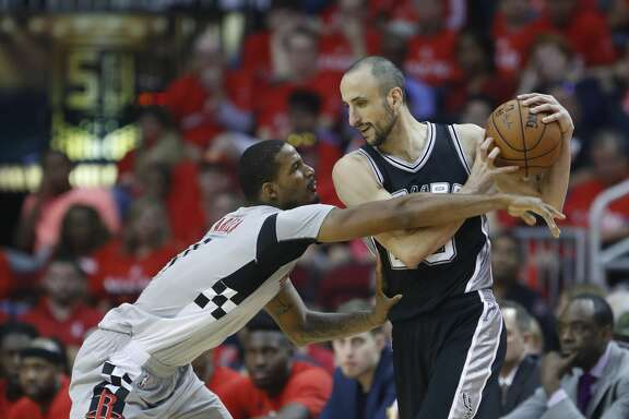 Houston Rockets forward Trevor Ariza (1) reaches for the ball held by San Antonio Spurs guard Manu Ginobili (20) during the first half of Game 6 of the second round of the Western Conference NBA playoffs at the Toyota Center, Thursday, May 11, 2017, in Houston. ( Karen Warren / Houston Chronicle )
