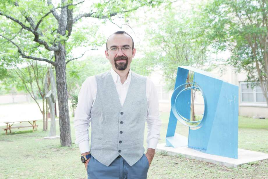 Mehmet Avci, 34 stands in the sculpture garden at St. Mary's University in San Antonio. Avci is graduating Saturday with a doctorate in counselor education and supervision. Photo: Federica Valabrega /For The San Antonio Express-News / © Federica Valabrega